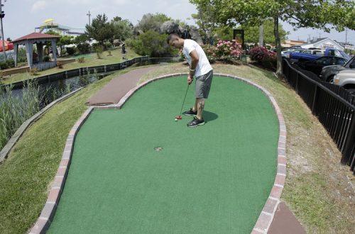 man playing putt putt